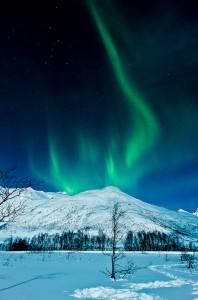Het poollicht te zien in Tromsø, Noorwegen Foto door Andi Gentsch (CC BY-SA 2.0)